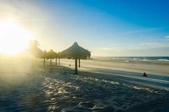 Several beach sun umbrellas at the sunset royalty free stock photos