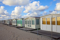 Several beachhouses in a row on beach Royalty Free Stock Images