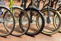 Several bicycle wheels Stock Images