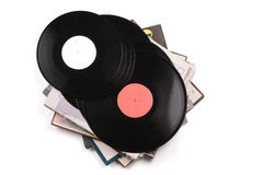Several big black vinyl records lying on the cardboard covers. Stock Images
