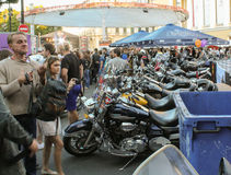 Several bikes among people. Royalty Free Stock Images
