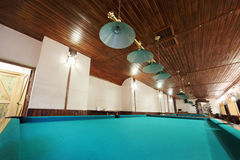 Several of billiard tables and lamps Stock Photo