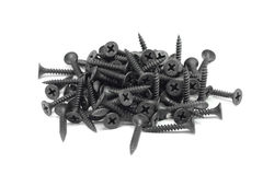 Several black anodized screws Royalty Free Stock Photography