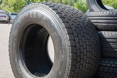 Several black rubber tires on sale with different tread pattern Royalty Free Stock Image