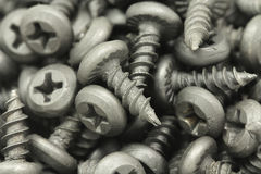 Several black screws background Royalty Free Stock Photos