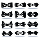 Several black silhouettes of bow tie with shadow Royalty Free Stock Images