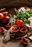 Several blood oranges with leaves stock photos