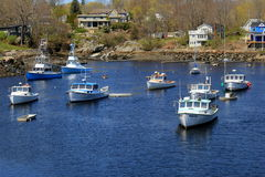 Several boats anchored in calm waters, Perkins Cove,Ogunquit, Maine,2016 Royalty Free Stock Images