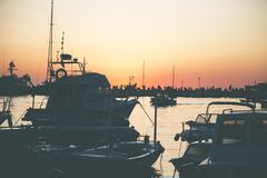 Several Boats on Calm Water during Golden Hour Royalty Free Stock Images