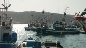 Several Boats Moored to the Jetty. The Sun is Shining stock video