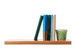 Several books are on the shelf. Object on a white background Stock Photo