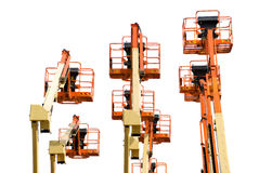 Several boom lifts isolated on white royalty free stock photography