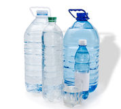 Several bottles and glassful of water Royalty Free Stock Images