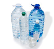 Several bottles and glassful of water Stock Images