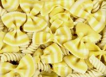 Bow tie lemon pasta background. Several Bowtie noodles make a Pasta background stock image