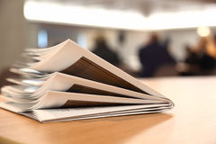 Several brochures on light table in room Royalty Free Stock Image