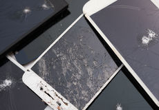 Several broken smart phone screens. On a white background Royalty Free Stock Images