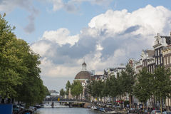 Several brown historical buildings in the center of Amsterdam Royalty Free Stock Photos