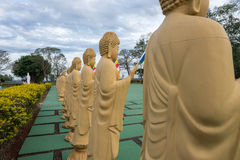 Several Buddha statues in perspective at the buddhist temple Royalty Free Stock Photo