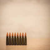 Several bullets on a wooden background Royalty Free Stock Image