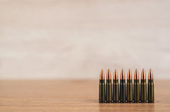 Several bullets on a wooden background Royalty Free Stock Photography