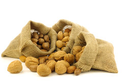 Several burlap bags with mixed nuts Stock Images