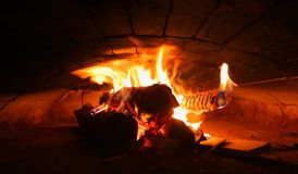 Several burning logs in a brick oven stock images