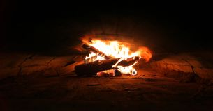 Several burning logs in a brick oven royalty free stock image