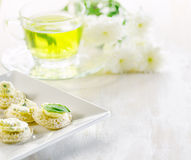 Several canapes and cup of herbal tea Royalty Free Stock Photos