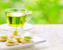Several canapes and cup of herbal tea Royalty Free Stock Image
