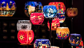 Several candle holders, with a christmas style. Edinburgh at Christmas Markets. Several candle holders, with a christmas style, on a dark background Royalty Free Stock Image