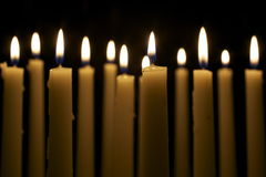 Several Candles on Black Background Royalty Free Stock Photography