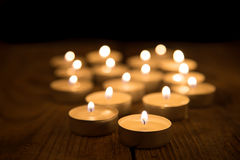 Several candles burning in the dark Royalty Free Stock Photo