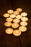 Several candles burning in the dark Royalty Free Stock Image