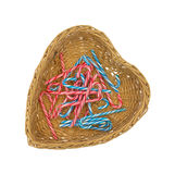 Several candy canes in heart shaped basket Royalty Free Stock Photos