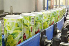 Several cans of mojitos on line in Ochakovo. MOSCOW - MAY 16: Several cans of mojitos on line in Ochakovo factory, on May 16, 2012 in Moscow, Russia. Ochakovo stock image