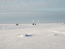 Several cars drift on the surface of the lake. Stock Photography