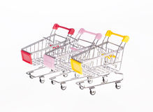 Carts on wheels with colorful handles Royalty Free Stock Photo