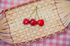 Several cherries in a basket Stock Photo