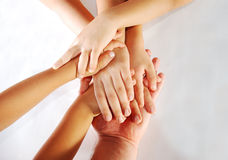 Several children hands together on one big Royalty Free Stock Photos