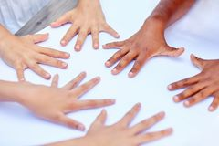 Several children lay hands on the table Royalty Free Stock Photos