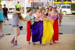 Several children ready to flee in sewn sacks at a pirate party d royalty free stock photography