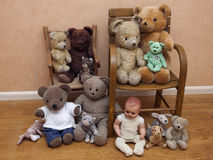 Several children's toys on old chair Stock Photos