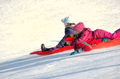 Several Children Sledding Royalty Free Stock Photos
