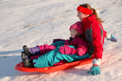 Several Children Sledding Royalty Free Stock Images