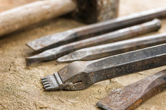 Several chisels with a mallet Stock Image