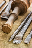 Several chisels with a wooden mallet Royalty Free Stock Photo