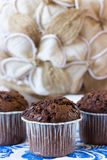 Several chocolate muffins. Chocolate muffins on the board written under gzhel Royalty Free Stock Photos