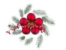 Several Christmas balls and small twigs of a Christmas tree. Isolated on white. Stock Photos