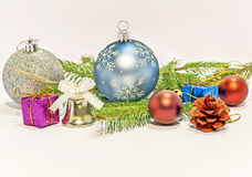 Several christmas decoration on green pine tree on white. Backgroound stock images